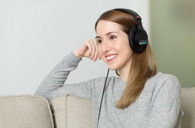 Woman Listening Music - Less Known And Cool Ways To De-stress From City Life