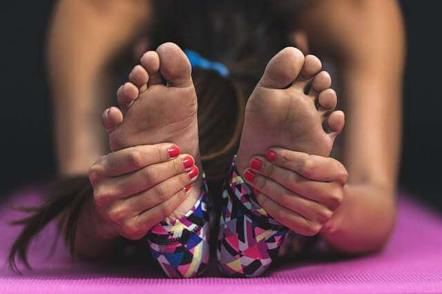 Young Women Showing Foot - 10 Health Benefits of taking a Foot Massage