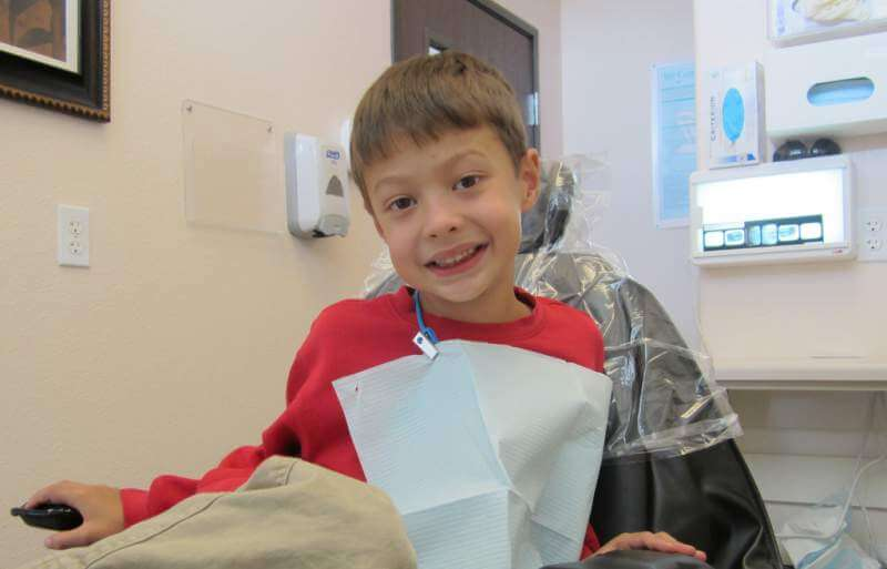 child first time at dental clinic - Teeth Grinding in Children: Causes and Treatments