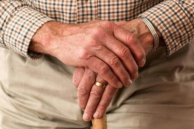 hands walking stick elderly old person - Common Arthritis Hurdles – When Daily Routine Becomes a Struggle