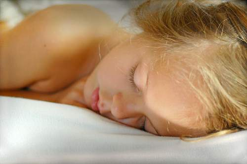 Sleeping girl - 5 Useful Hygiene Tips for a Healthier Bedtime Routine
