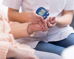nurse-checking-blood-sugar-level