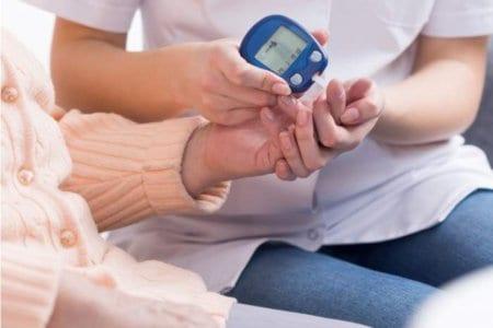 nurse-checking-blood-sugar-level