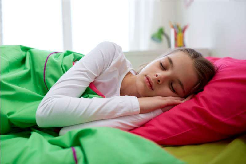 girl-sleeping-in-her-bed-at-home