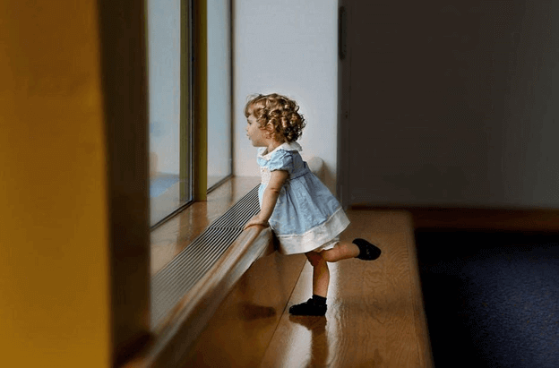 Kid infront of window