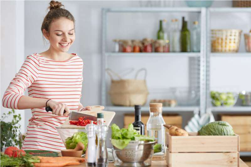 Woman preparing vegetarian meal