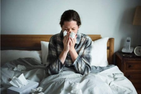 a-woman-suffering-from-flu-in-bed