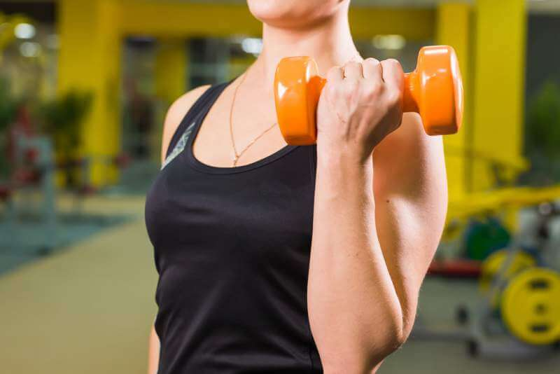 fit-girl-exercising-with-dumbbells-muscular-woman