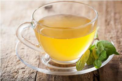herbal-sage-tea-with-green-leaf-in-glass-cup
