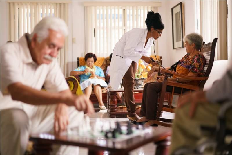 hospice-doctor-measuring-blood-pressure-to-senior