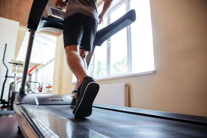 legs-of-young-man-athlete-running-on-treadmill