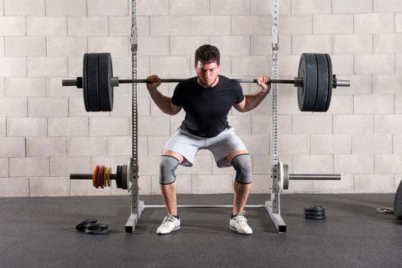 man-performing-a-crossfit-back-squat-exercise