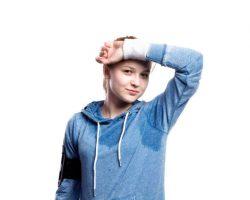 teenage-girl-in-blue-sweatshirt-studio-shot