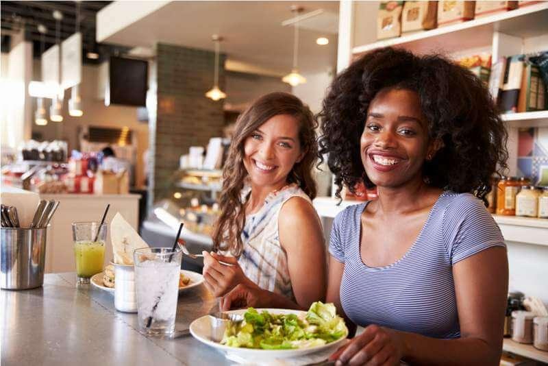 two-women-enjoying-breakfast-date-in-delicatessen