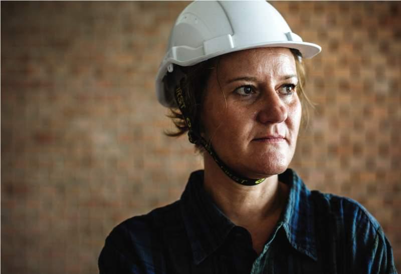 woman-constructor-wearing-hard-helmet