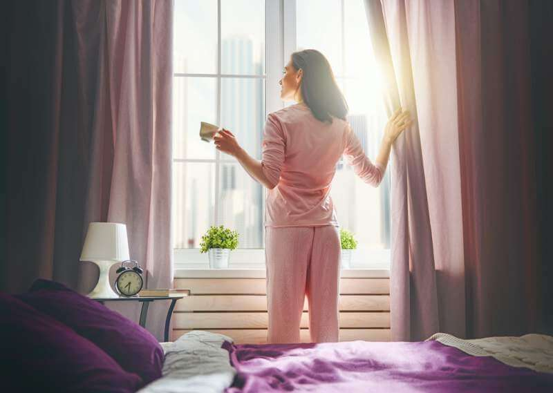 woman-enjoying-sunny-morning
