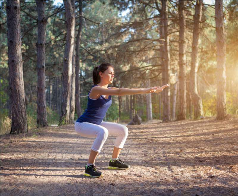 young-beautiful-girl-sports-in-the-autumn-forest