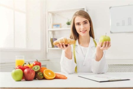 dietitian-nutritionist-with-bun-and-apple