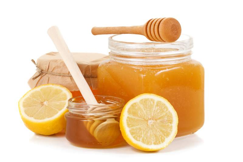 pot-of-honey-and-sliced-lemon