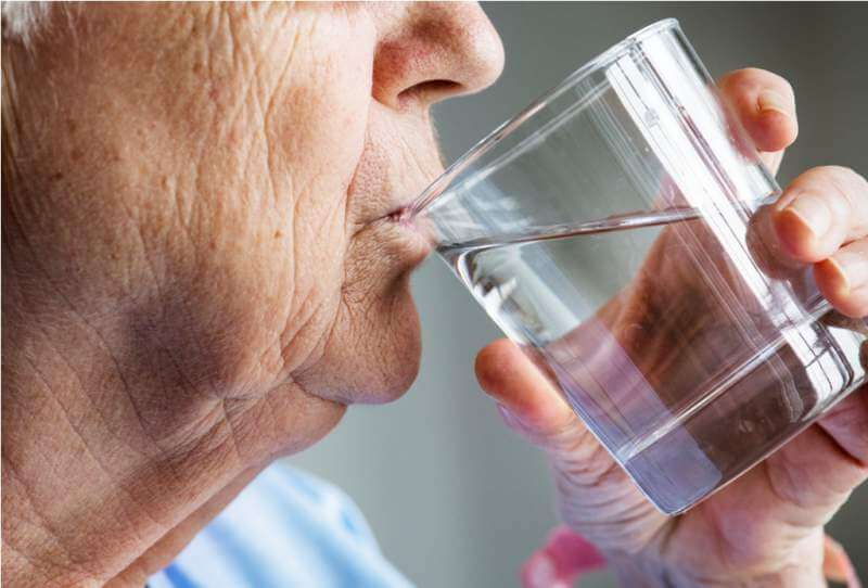 side-view-of-elderly-woman-drinking-water