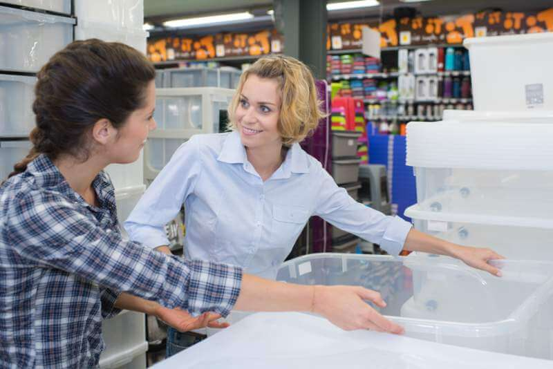 women-looking-at-plastic-tubs-in-shop