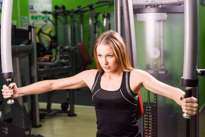 young-fitness-woman-execute-exercise