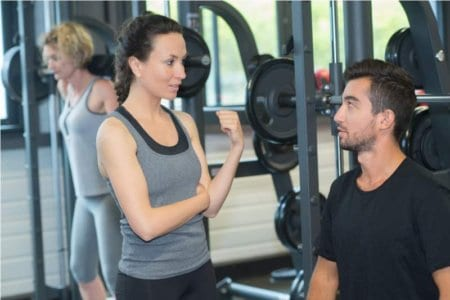 young-sporty-couple-in-gym