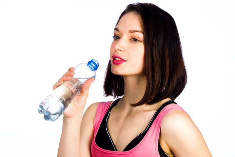 young-woman-in-sportswear-with-a-bottle