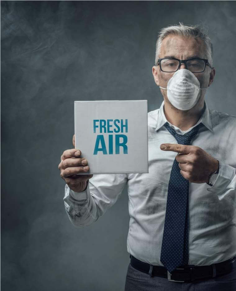 businessman-holding-a-sign-and-air-pollution