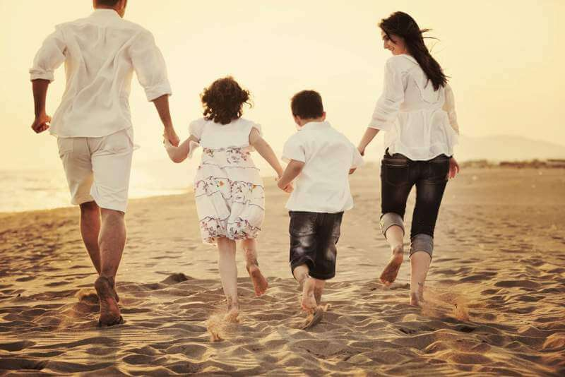 happy-young-family-have-fun-on-beach-at-sunset