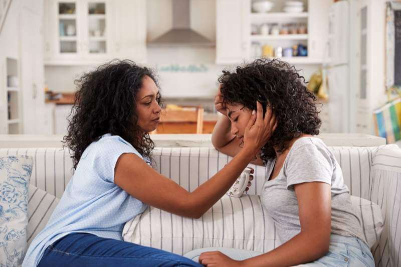 mother-talking-with-unhappy-teenage-daughter