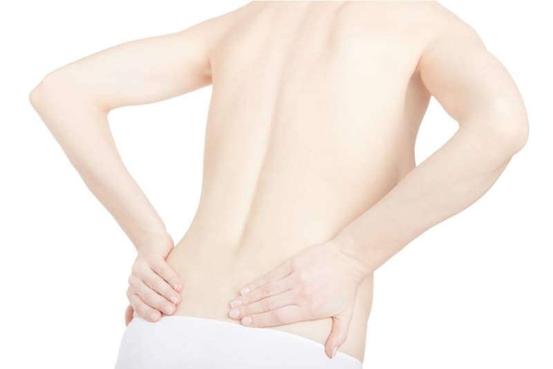 young-adult-woman-with-back-pain