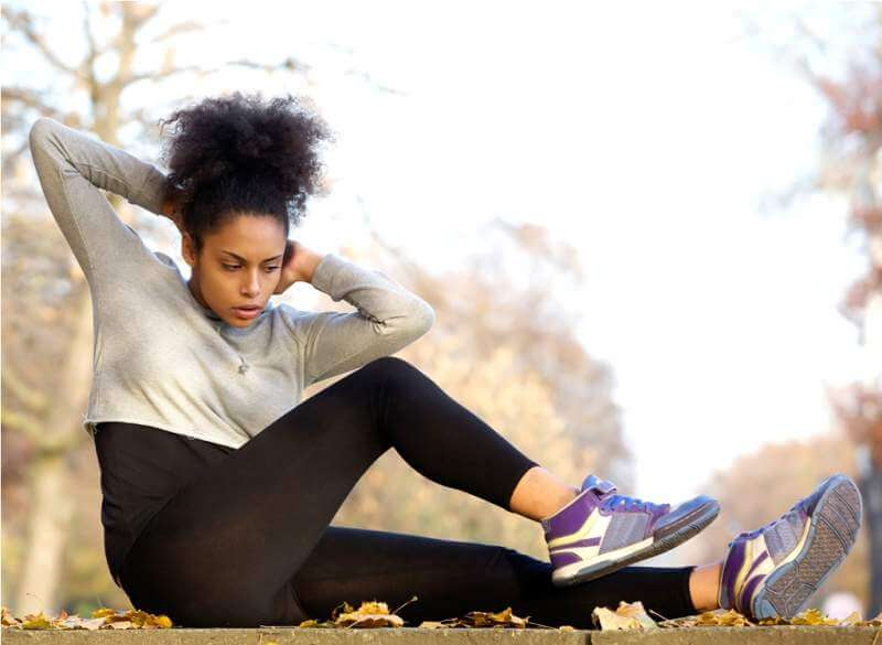 young-african-american-woman-exercising-sit-ups