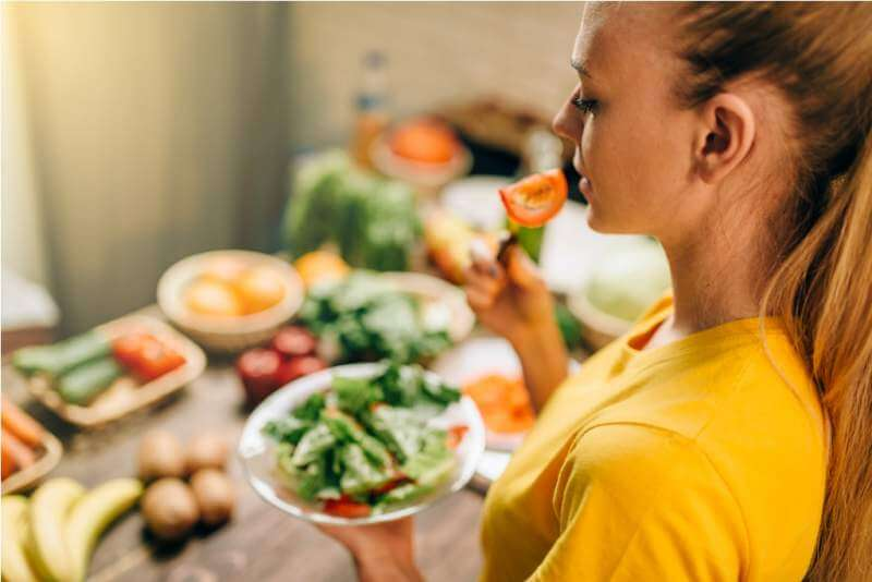 young-woman-eating-healthy-eco-food