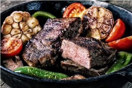 appetizing-beef-steak-in-frying-pan