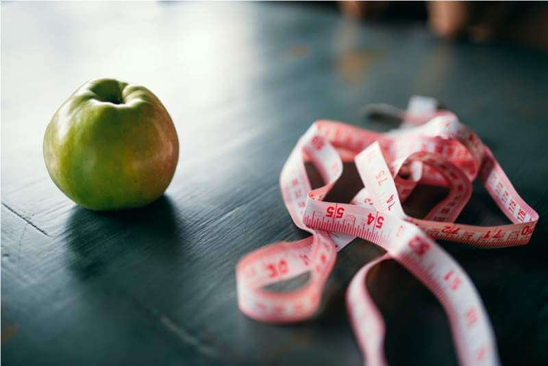 apple-and-pink-measuring-tape-weight-loss