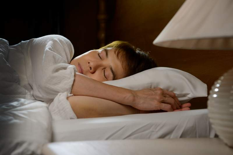 beautiful-woman-sleeping-in-her-bed-at-night