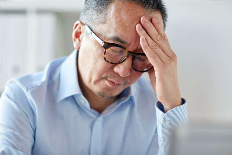 businessman-suffering-from-headache-at-office