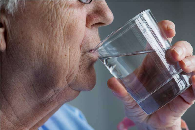 elderly-woman-drinking-water
