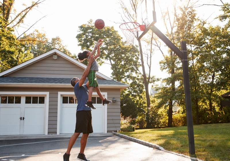 father-and-son-playing-basketball-on-driveway