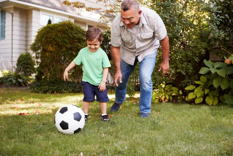grandfather-playing-soccer-in-garden