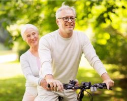 happy-senior-couple-riding-bicycle-at-park
