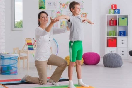 physiotherapist-exercising-with-a-school-boy