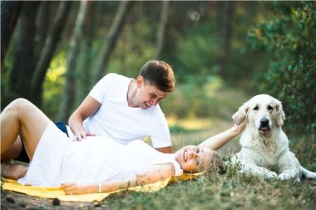 pregnant-woman-with-husband-lying-in-the-park