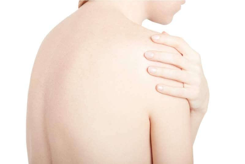 young-woman-touching-her-painful-shoulder
