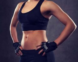 close-up-of-young-woman-body-in-gym