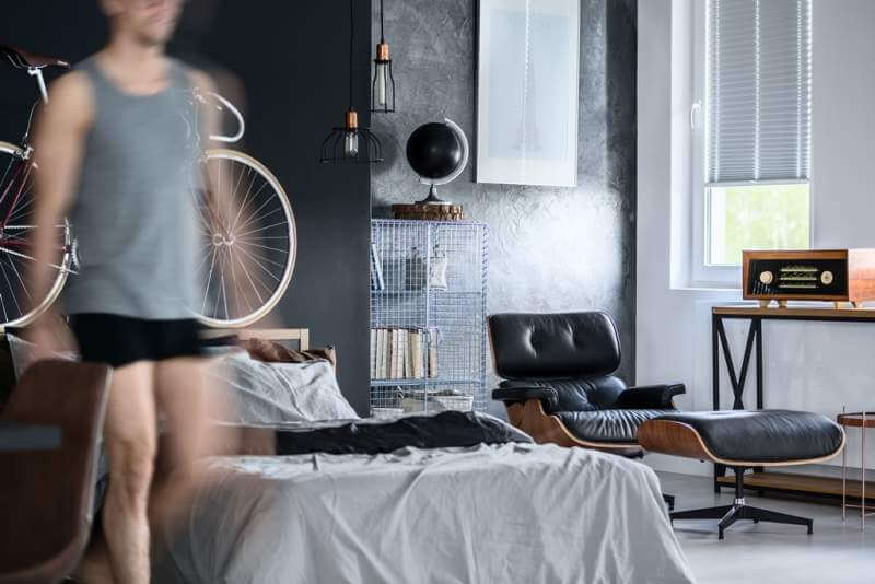 man-in-a-bedroom