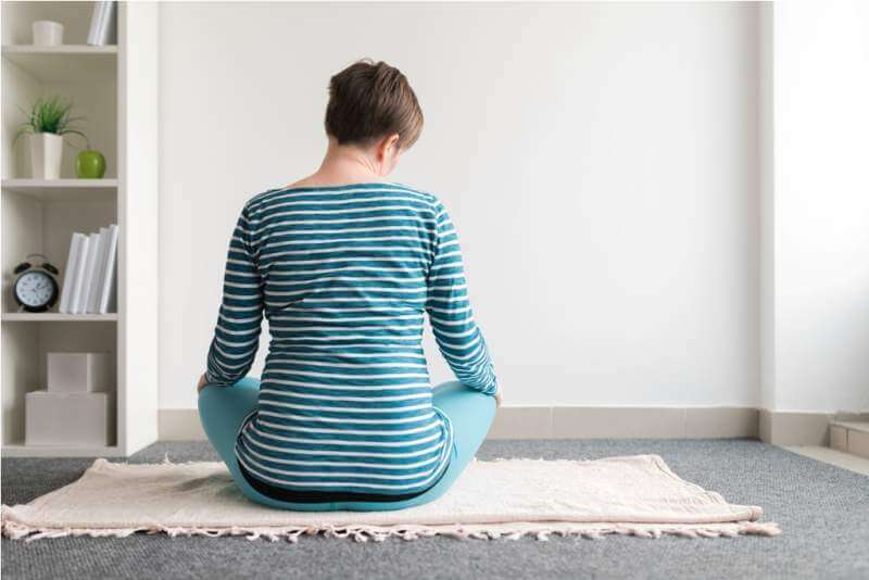 pregnant-woman-practicing-yoga-exercise-at-home