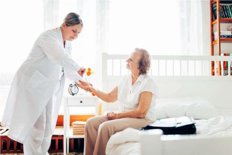 providing-care-for-elderly-doctor-visiting