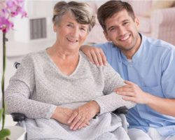 smiling-carer-with-senior-in-rest-home